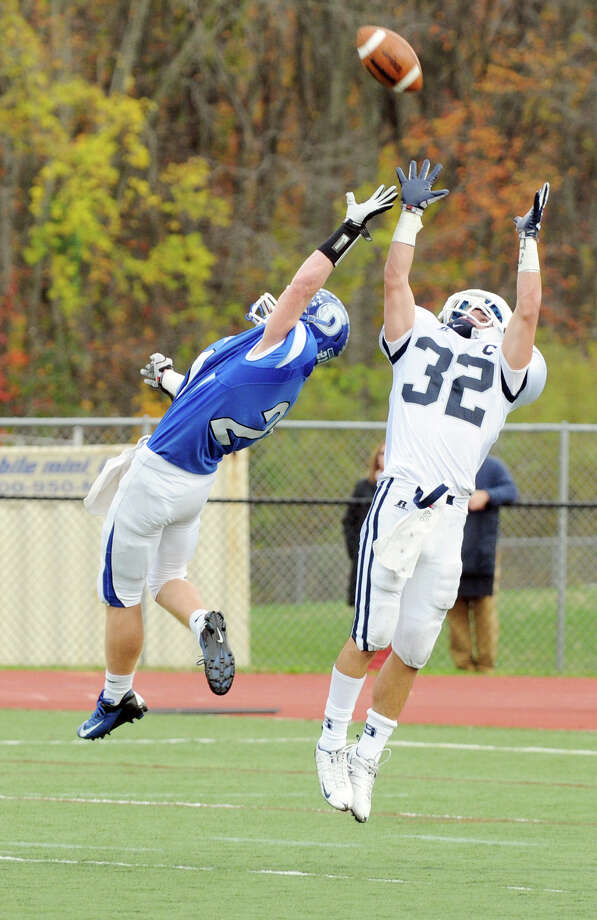 Darien's Nicholas Lombardo, left, and Staples' Greg Strauss battle for the ball as Darien High School hosts Staples in a football game in Darien, Conn., Oct. 27, 2012. Photo: Keelin Daly
