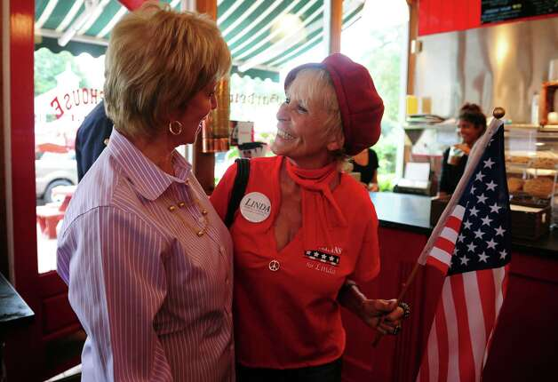 Republican Senate nominee Linda McMahon talks with a supporter at Firehouse Deli while campaigning in Fairfield with State Senate Republican Leader John McKinney Wednesday, August 15, 2012. Photo: Autumn Driscoll