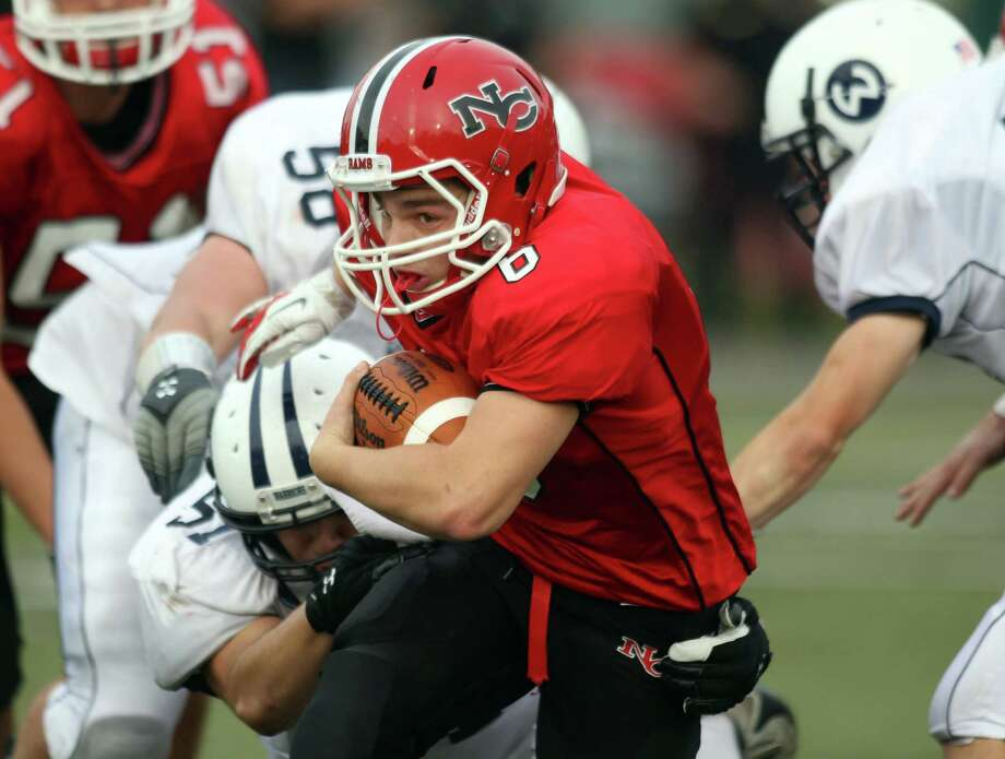 New Canaan QB Teddy Bossidy surges upfield for yardage in New Canaan's 21-14 win over Witon. Bossidy would score on a 46 yard third quarter run to key the New Canaan win. Photo: J. Gregory Raymond