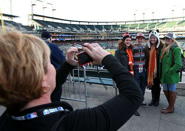 Mari anne Barr takes a family portrait, of her Giants fans, Kate Barr, Blake Barr, Eileen Barr and Marry Barr at Comerica Park in Detroit, Mi., on Saturday, Oct. 27, 2012 prior to the start of game 3 of the World Series between the San Francisco Giants and the Detroit Tigers. Photo: Lance Iversen, The Chronicle