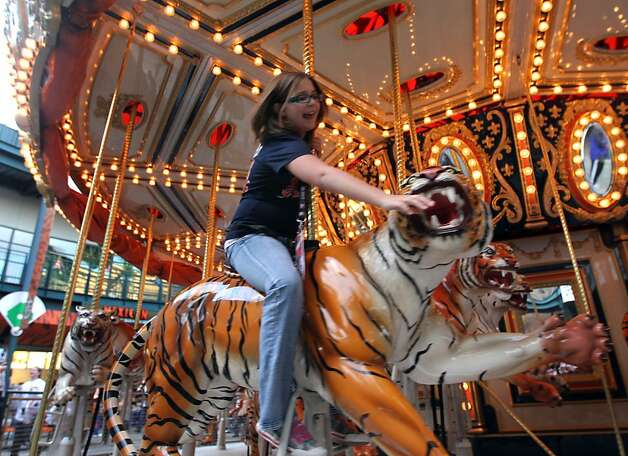 A girl rides the marry-go-round at Comerica Park in Detroit, Mi., on Saturday, Oct. 27, 2012 prior to the start of game 3 of the World Series between the San Francisco Giants and the Detroit Tigers. Photo: Lance Iversen, The Chronicle