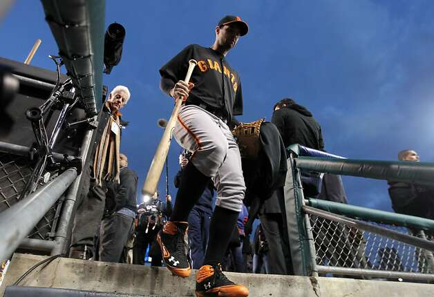 San Francisco Giants Brandon Belt returns to the club house after batting practice at Comerica Park in Detroit, Mi., on Saturday, Oct. 27, 2012. Photo: Lance Iversen, The Chronicle