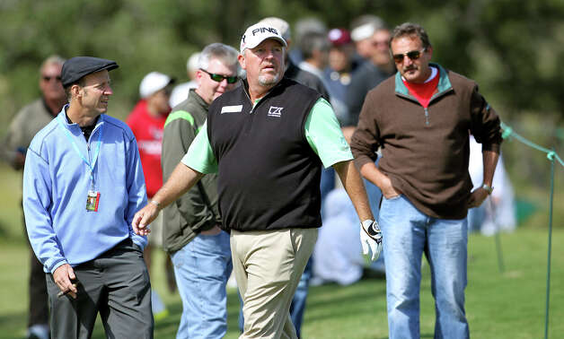 Mark Calcavecchia inspects the 14th fairway before his approach shot during the second round of the 2012 AT&T Championship at the AT&T Canyons course on October 27, 2012. Photo: Tom Reel, Express-News / ©2012 San Antono Express-News