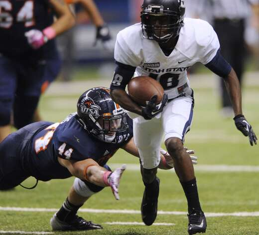 UTSA linebacker Steven Kurfehs (44) lunges at Utah State receiver Bruce Natson during WAC football action at the Alamodome on Saturday, Oct. 27, 2012. (San Antonio Express-News)