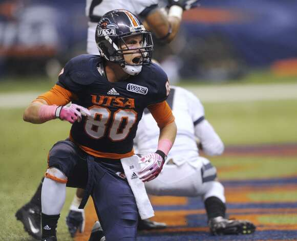 UTSA receiver Cole Hicks reacts after catching a touchdown pass against Utah State during WAC football action at the Alamodome on Saturday, Oct. 27, 2012. (San Antonio Express-News)