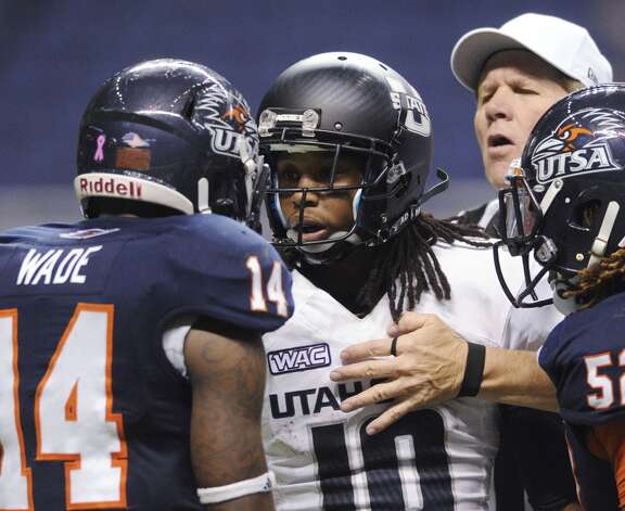 UTSA's Triston Wade (14) has words with Chuck Jacobs (10) of Utah State as the referee intervenes during WAC football action at the Alamodome on Saturday, Oct. 27, 2012. (San Antonio Express-News)