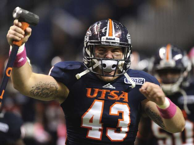 UTSA defensive end Cody Rogers, who attended Brandeis High School, carries a hammer as he enters the Alamodome with his teammates for their WAC football game against Utah State on Saturday, Oct. 27, 2012. (San Antonio Express-News)