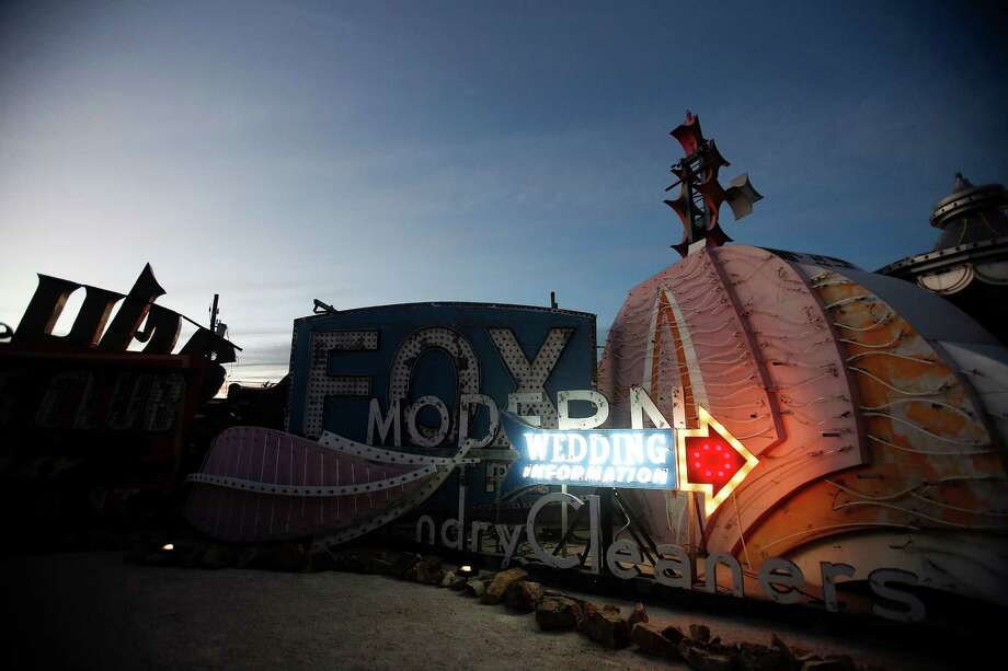 A wedding sign is illuminated during a preopening celebration at the Neon Museum in Las Vegas, Oct. 23, 2012. The museum opened on Saturday, Oct. 27, 2012, after more than 15 years of effort. Photo: Isaac Brekken, New York Times / NYTNS