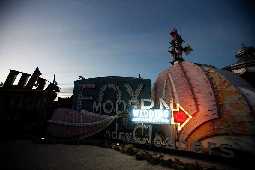 A wedding sign is illuminated during a preopening celebration at the Neon Museum in Las Vegas, Oct. 23, 2012. The museum opened on Saturday, Oct. 27, 2012, after more than 15 years of effort.