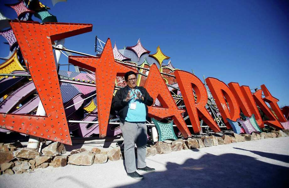 Justin Favela, the programs coordinator for the Neon Museum, in front of the Stardust sign at the museum's boneyard in Las Vegas, Oct. 24, 2012. The museum opened on Saturday, Oct. 27, 2012, after more than 15 years of effort. Photo: ISAAC BREKKEN, New York Times / NYTNS