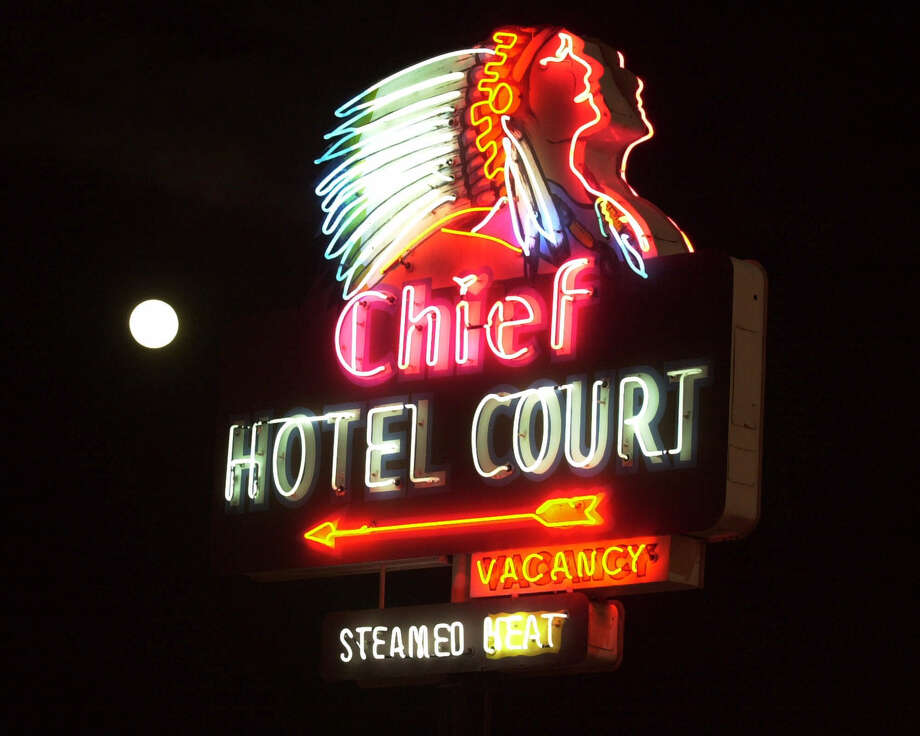 A full moon rises over the 1940 Chief Hotel Court sign on Fremont Street in downtown Las Vegas, Jan. 9, 2001. The sign was restored and placed downtown by the Neon Museum, a nonprofit group set up by the city to preserve old Las Vegas neon signs. Photo: Laura Rauch, Associated Press / AP