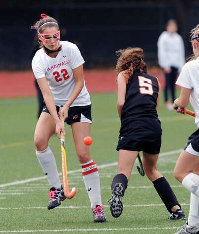 At left, Elizabeth Stillman # 22 of Greenwich goes for the ball along with Ashhley Kuppersmith # 22 of Stamford during the FCIAC field hockey tournament match between Stamford High School and Greenwich High School at Greenwich, Saturday afternoon, Oct. 27, 2012. Photo: Bob Luckey / Greenwich Time