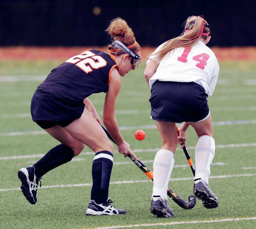 At left, Taylor Mills # 22 of Stamford goes for the ball against Anne Dunster # 14 of Greenwich during the FCIAC field hockey tournament match between Stamford High School and Greenwich High School at Greenwich, Saturday afternoon, Oct. 27, 2012. Photo: Bob Luckey / Greenwich Time