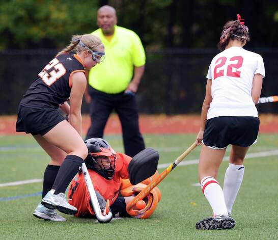 At right, Elizabeth Stillman # 22 of Greenwich plays the rebound off a stop by Stamford goalie Lesly Sanchez as teammate Ciara Killian # 23 attempts to clear the ball during the FCIAC field hockey tournament match between Stamford High School and Greenwich High School at Greenwich, Saturday afternoon, Oct. 27, 2012. Photo: Bob Luckey / Greenwich Time