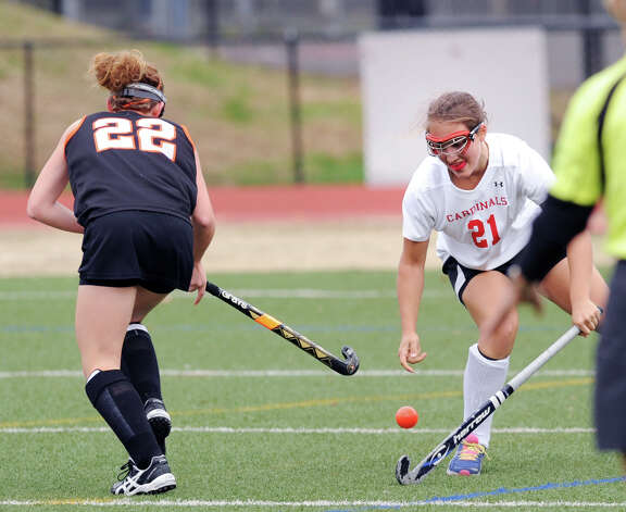 At left, Stamford's Taylor Mills # 22 mixes it up with Lizzy Trotta # 21 of Greenwich during the FCIAC field hockey tournament match between Stamford High School and Greenwich High School at Greenwich, Saturday afternoon, Oct. 27, 2012. Photo: Bob Luckey / Greenwich Time