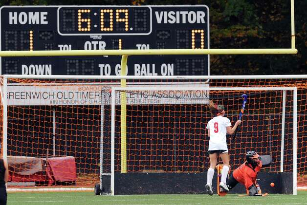 Stamford goalie Lesly Sanchez, right, makes a stop on a penalty shot by Meghan Collins # 9 of Greenwich during the FCIAC field hockey tournament match between Stamford High School and Greenwich High School at Greenwich, Saturday afternoon, Oct. 27, 2012. Photo: Bob Luckey / Greenwich Time