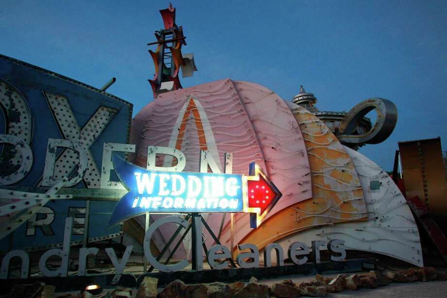 In this Oct. 23, 2012 photo, signs from Las Vegas's past are seen during the grand opening of the Neon Museum in Las Vegas. Photo: AP Photo/The Las Vegas Sun, Sam Morris / Las Vegas Sun