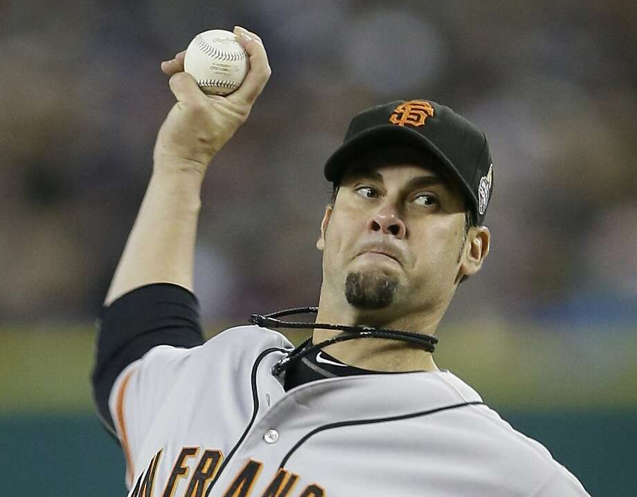 San Francisco Giants' Ryan Vogelsong throws during the first inning of Game 3 of baseball's World Series against the Detroit Tigers Saturday, Oct. 27, 2012, in Detroit.  Photo: Matt Slocum, Associated Press