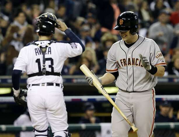 San Francisco Giants' Buster Posey reacts in front of Detroit Tigers catcher Alex Avila after striking out during the first inning of Game 3 of baseball's World Series Saturday, Oct. 27, 2012, in Detroit. (AP Photo/David J. Phillip) Photo: David J. Phillip, Associated Press