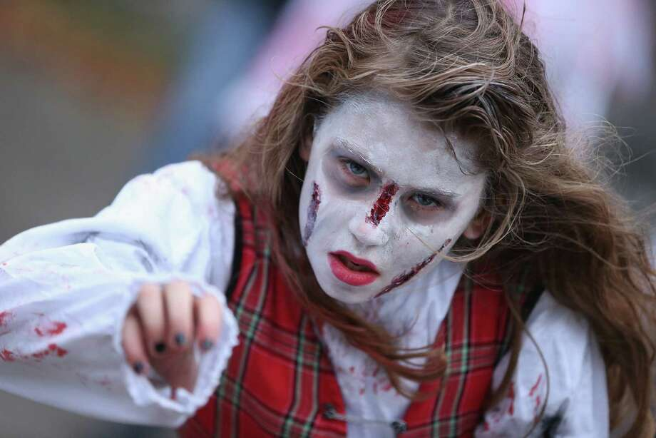 "A zombie enthusiast practices being scary before setting out on a ""Zombie Walk"" in the city center on October 27, 2012 in Berlin, Germany.. Photo: Sean Gallup, Getty Images / 2012 Getty Images"