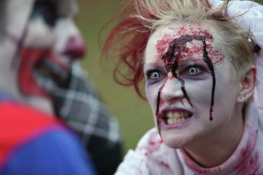 "Zombie enthusiasts gather before setting out on a ""Zombie Walk"" in the city center on October 27, 2012 in Berlin, Germany. Approximately 150 zombies, who had organized themselves through Facebook, walked and limped across Alexanderplatz, growled and moaned at passersby and performed their jerking dances. Photo: Sean Gallup, Getty Images / 2012 Getty Images"