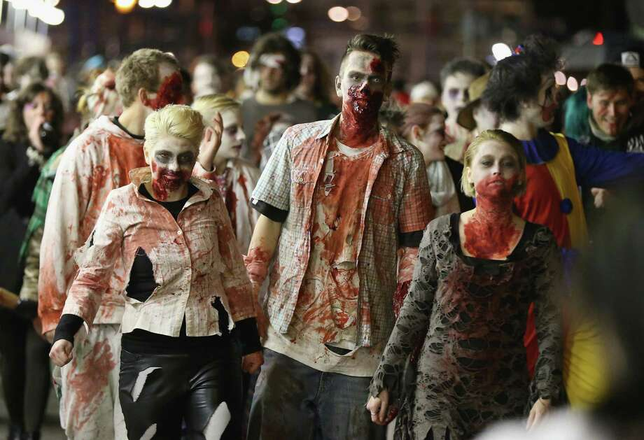 "Zombie enthusiasts set out on a ""Zombie Walk"" in the city center on October 27, 2012 in Berlin, Germany. Approximately 150 zombies, who had organized themselves through Facebook. Photo: Sean Gallup, Getty Images / 2012 Getty Images"