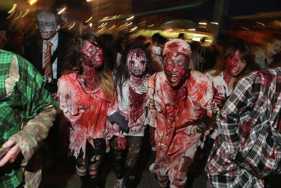 "Zombie enthusiasts set out on a ""Zombie Walk"" in the city center on October 27, 2012 in Berlin, Germany. Photo: Sean Gallup, Getty Images / 2012 Getty Images"
