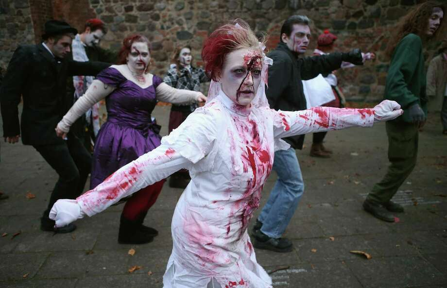 "Zombie enthusiasts rehearse a dance before setting out on a ""Zombie Walk"" in the city center on October 27, 2012 in Berlin, Germany. Photo: Sean Gallup, Getty Images / 2012 Getty Images"