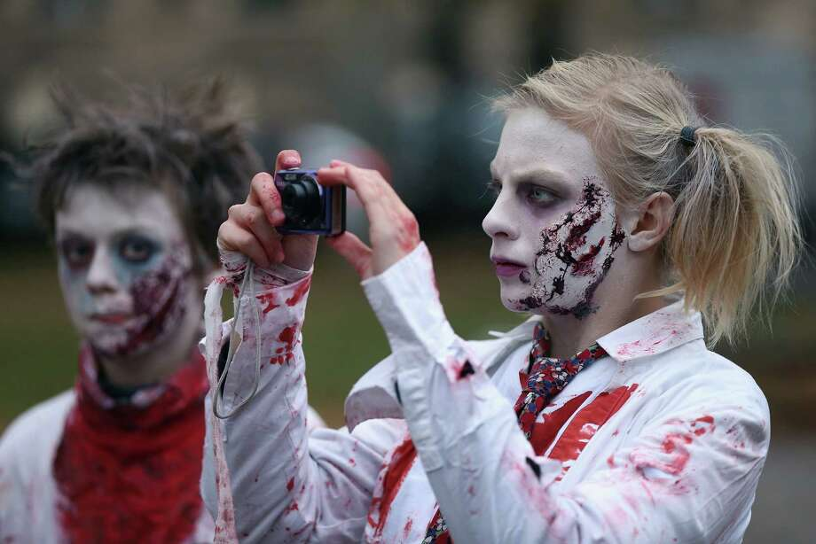 "Zombie enthiusiasts gather before setting out on a ""Zombie Walk"" in the city center on October 27, 2012 in Berlin, Germany. Photo: Sean Gallup, Getty Images / 2012 Getty Images"