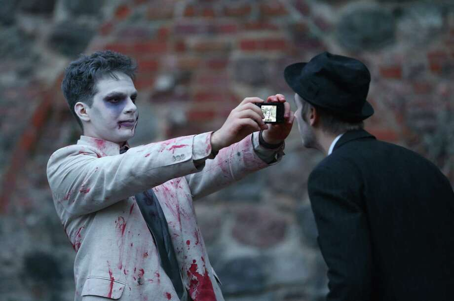 "Zombie enthusiasts  gather before setting out on a ""Zombie Walk"" in the city center on October 27, 2012 in Berlin, Germany. Photo: Sean Gallup, Getty Images / 2012 Getty Images"