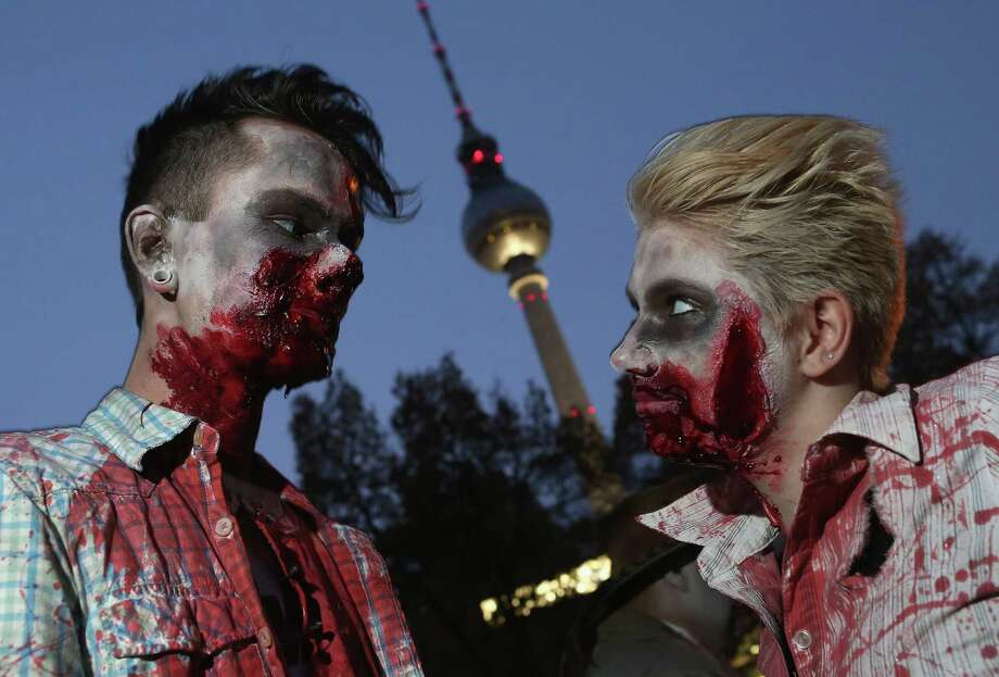 "Zombie enthusiasts  gather near the broadcast tower at Alexanderplatz before setting out on a ""Zombie Walk"" in the city center on October 27, 2012 in Berlin, Germany. Photo: Sean Gallup, Getty Images / 2012 Getty Images"