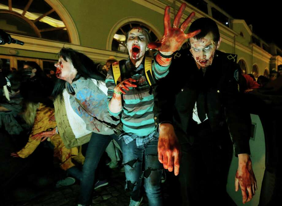 People dressed as ghouls and zombies gather at a Zombie festival in St.Petersburg, Russia, Saturday, Oct. 27, 2012,  as part of Halloween celebrations. (AP Photo/Dmitry Lovetsky) Photo: Dmitry Lovetsky, Associated Press / AP