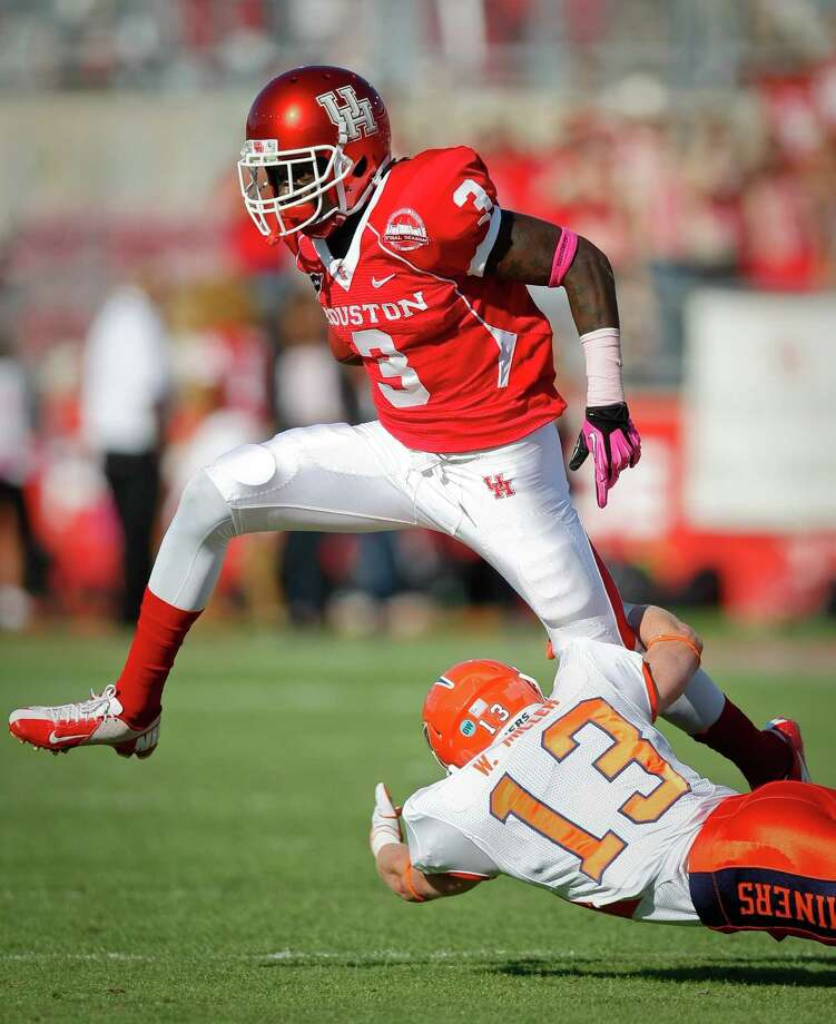 Houston wide receiver Deontay Greenberry (3) jumps over UTEP defensive back Wesley Miller (13) after making a midfield catch during the first quarter of a NCAA football game, Saturday, Oct. 27, 2012, in Robertson Stadium in Houston.  ( Nick de la Torre / Houston Chronicle ) \ Photo: Nick De La Torre, Houston Chronicle / Houston Chronicle