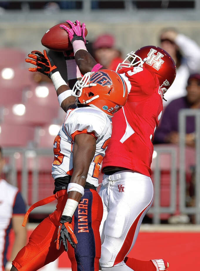 Houston wide receiver Deontay Greenberry (3) out jumps UTEP defensive back Terr'l Mark (23) for a touchdown catch during the first quarter of a NCAA football game, Saturday, Oct. 27, 2012, in Robertson Stadium in Houston.  ( Nick de la Torre / Houston Chronicle ) \ Photo: Nick De La Torre, Houston Chronicle / Houston Chronicle