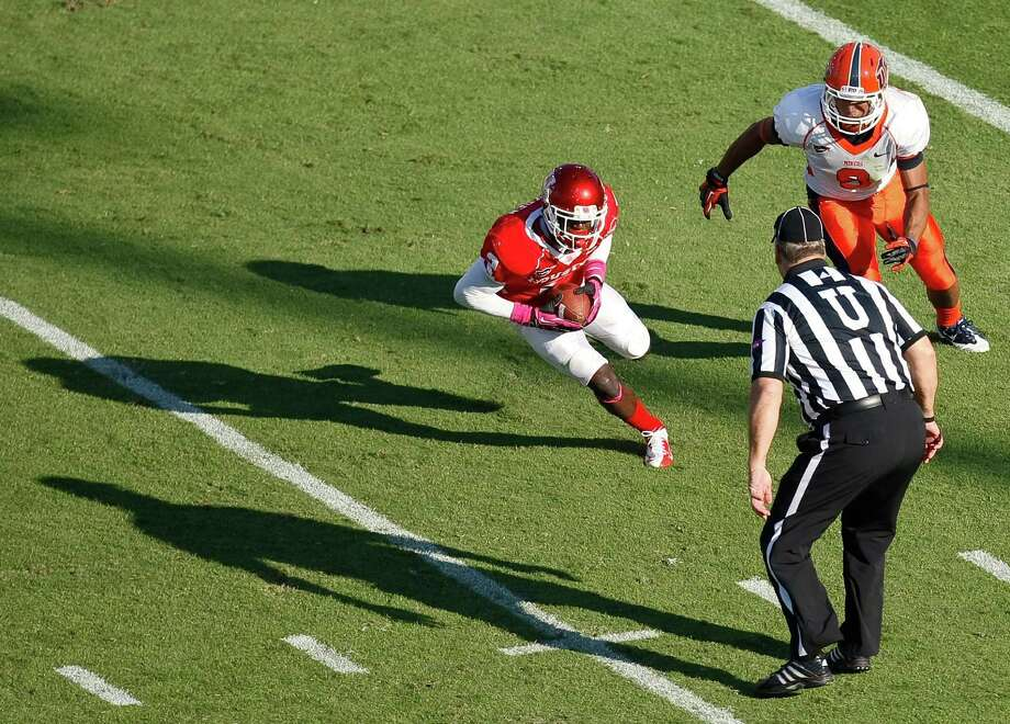 Houston defensive back D.J. Hayden (2) intercepts a pass intended for UTEP wide receiver Jordan Leslie (9) during the second quarter of a NCAA football game, Saturday, Oct. 27, 2012, in Robertson Stadium in Houston.  ( Nick de la Torre / Houston Chronicle ) \ Photo: Nick De La Torre, Houston Chronicle / Houston Chronicle