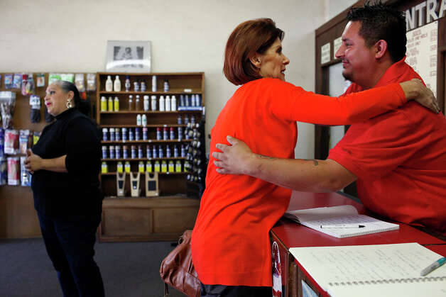 "Longtime customer Diane Rath, right, embraces Bryan Rodriguez while his mother, Estela Salazar, left, talks to another longtime customer on the last day Central Shoe Repair will be open for at least two months in Alamo Heights on Saturday, Oct. 27, 2012. The Salazar family is closing the store temporarily to focus on Eddie Salazar's current battle with cancer and hopes to reopen in January. ""It's just like family. You watch the children and grandchildren grow up,"" Rath says of the Salazars. Photo: Lisa Krantz, San Antonio Express-News / San Antonio Express-News"