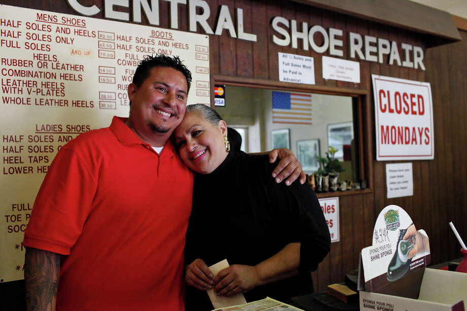 Bryan Rodriguez embraces his mother, Stela Salazar, on the last day of business at Central Shoe and Boot Repair in late October. The family ran the business since 1987. Photo: Lisa Krantz, San Antonio Express-News / © 2012 San Antonio Express-News