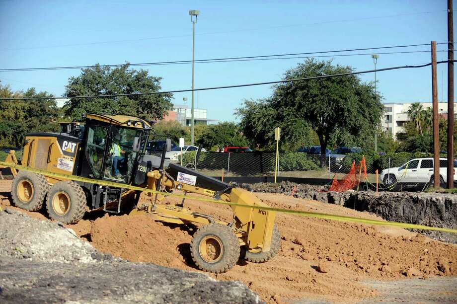 Work is under way on the new residence, commercial and parking project for San Antonio College. The first phase of apartments is due to open in August. Photo: Billy Calzada, San Antonio Express-News / © 2012 San Antonio Express-News