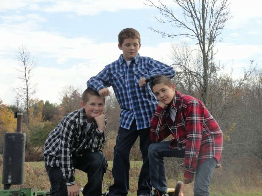 Kyle Waddell, Jesse Waddell and Alex Caiazzo strike a pose while some family photos were being taken recently at their great-grandmother's farm in Duanesburg. (Tami D'Itria)