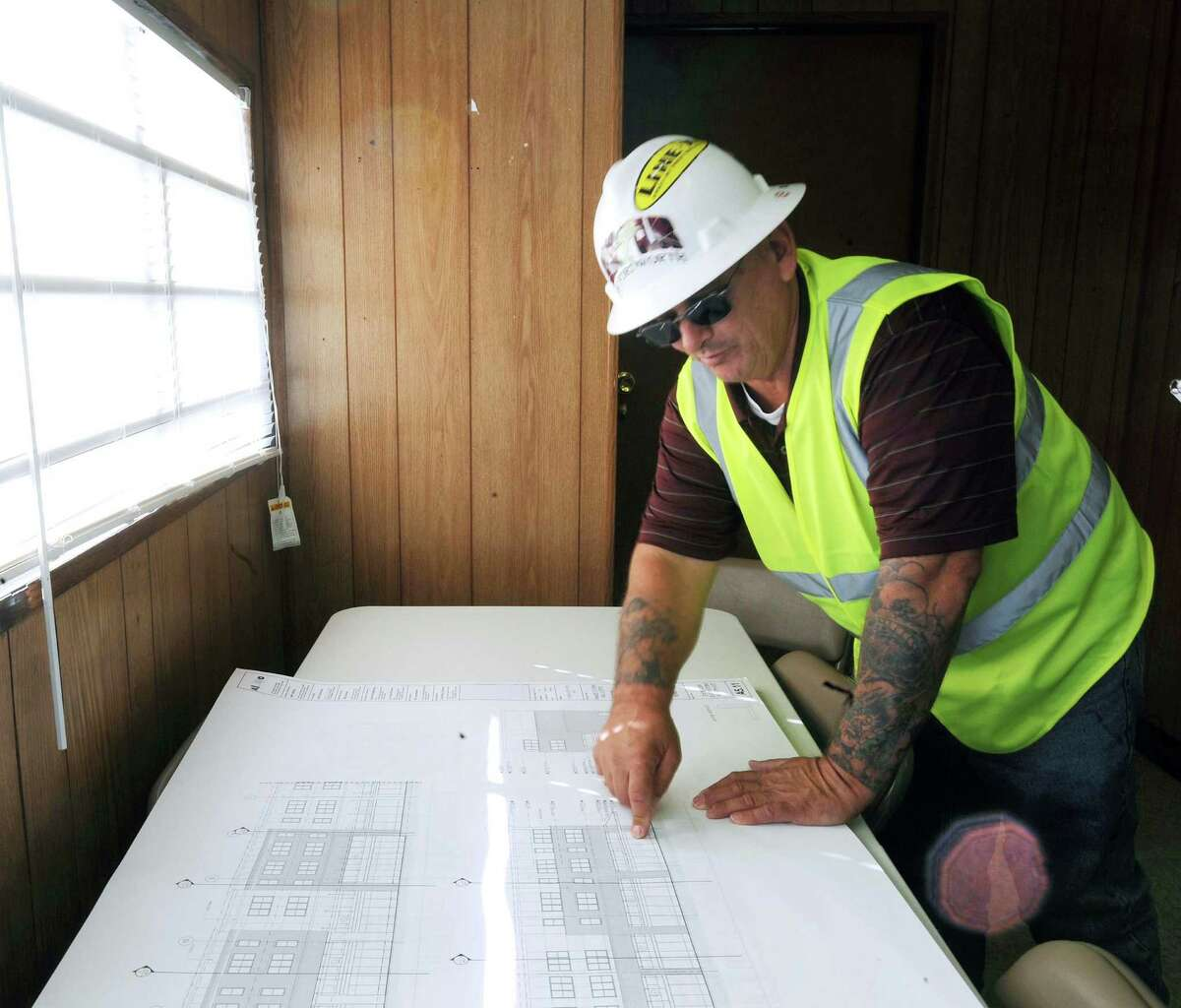 Michael Hotelling, NRP Group project superintendent, looks over plans for the development.