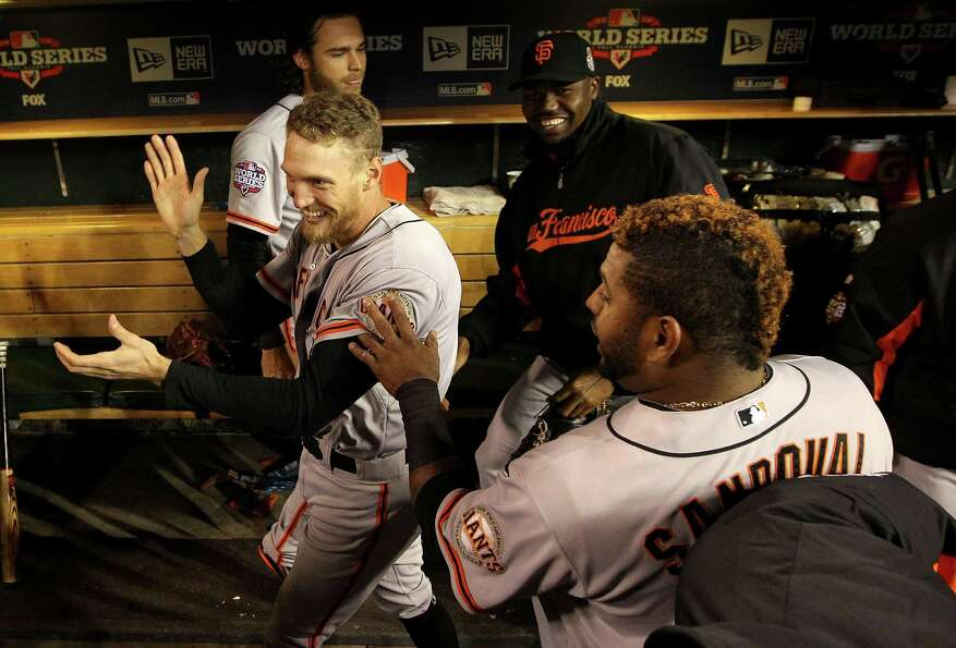 Pablo Sandoval #48 of the San Francisco Giants jokes with teammate Hunter Pence #8 in the dugout pri