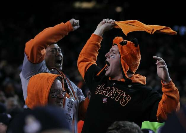 Giants' fans celebrate the first run of the game in the 2nd inning during game 3 of the World Series at Comerica Park on Saturday, Oct. 27, 2012 in Detroit, MI. Photo: Lance Iversen, The Chronicle