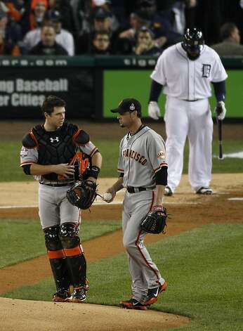 Giants' catcher Buster Posey talks with Giants' pitcher Ryan Vogelsong on the mound in the 1st inning during the World Series game 3 at Comerica Park in Detroit, MI, on Saturday, Oct. 27, 2012. Photo: Carlos Avila Gonzalez, The Chronicle
