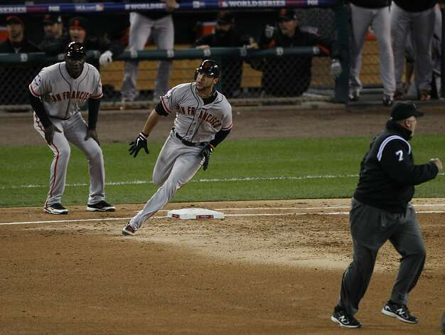 Giants' left fielder Gregor Blanco rounds 1st base after hitting a triple in the 2nd inning that scored 1 during the World Series game 3 at Comerica Park in Detroit, MI, on Saturday, Oct. 27, 2012. Photo: Carlos Avila Gonzalez, The Chronicle
