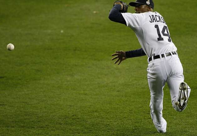 Tigers' center fielder Austin Jackson can't come up with a Giants' shortstop Brandon Crawford single in the 2nd inning that scored 1 during the World Series game 3 at Comerica Park in Detroit, MI, on Saturday, Oct. 27, 2012. Photo: Carlos Avila Gonzalez, The Chronicle