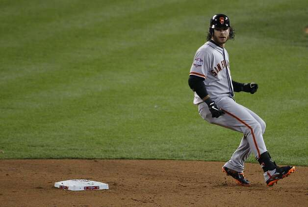 Giants' shortstop Brandon Crawford stops at 2nd base on an error by Tigers' center fielder Austin Jackson in the 2nd inning during the World Series game 3 at Comerica Park in Detroit, MI, on Saturday, Oct. 27, 2012. Photo: Carlos Avila Gonzalez, The Chronicle