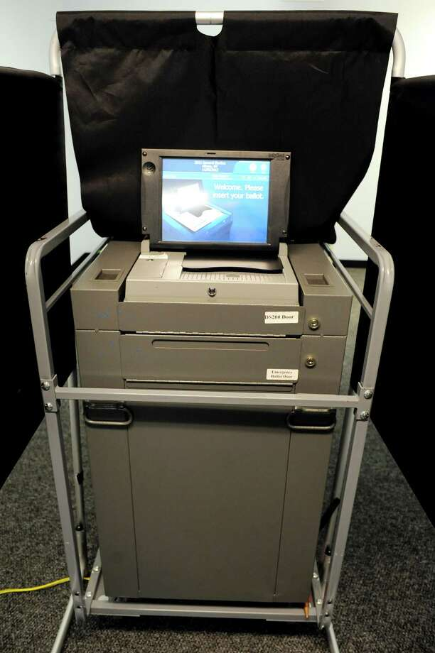 A voting machine that scans a completed ballot  on Thursday, Oct. 25, 2012, at the Albany County Board of Elections in Albany, N.Y. (Cindy Schultz / Times Union) Photo: Cindy Schultz / 00019844A