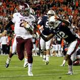 Texas A&M quarterback Johnny Manziel (2) runs in for a touchdown past Auburn defensive back Demetruce McNeal (12) during the first half of an NCAA college football game on Saturday, Oct. 27, 2012, in Auburn, Ala. (AP Photo/Butch Dill)