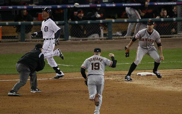 Giants' 2nd baseman Marco Scutaro runs off the field after Brandon Belt completes a double play against Tigers' left fielder Quintin Berry in the 3rd inning during the World Series game 3 at Comerica Park in Detroit, MI, on Saturday, Oct. 27, 2012. Photo: Carlos Avila Gonzalez, The Chronicle