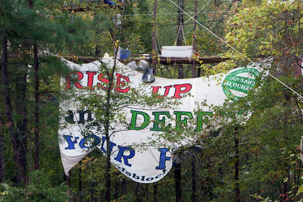 A sign hung by protesters showing their opposition for TransCanada's Keystone XL project is seen in Wood County, Wednesday, Oct. 24, 2012, in Winnsboro.